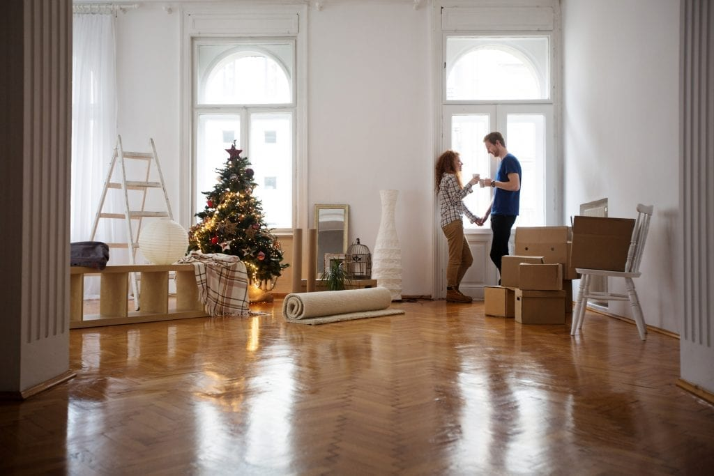 Young Couple Moving in at Christmas